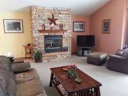 craftsman living room with carpet u0026 stone fireplace in loganville