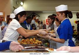 kitchen serving food in homeless stock photos kitchen serving