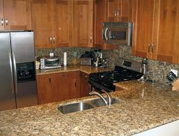 giallo fiorito granite with oak cabinets giallo fiorito kitchen png