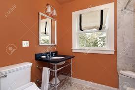 Orange Walls Powder Room In Suburban Home With Orange Walls Stock Photo