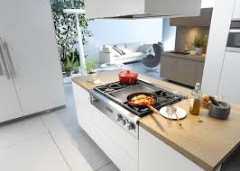 Miele Ran op Cooktop with built in griddle Miele Wall Ovens