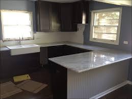 kitchen light wood kitchen beige cabinets dark green kitchen