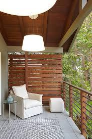 portable greenhouse with wood slat screen balcony mediterranean