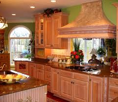 green wall theme and brown wooden kitchen cabinet connected by
