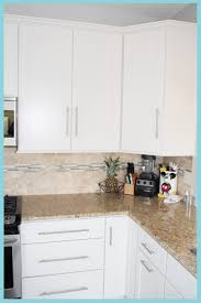 kitchen ideas with white cabinets and stainless steel appliances white l shape open kitchen by mastercraft kitchen bath