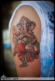 colourful lord ganesha with dholki and hand cymbal tattoo design