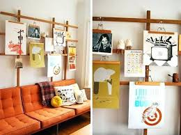 hang pictures without nails hang photos on wall without nails 3 ways display art without frames
