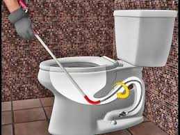 how to clear a toilet clog snake a toilet easily by using an