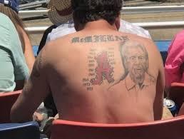 alabama fan sports large nick saban portrait tattooed on his back
