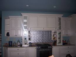 kitchen style metallic backsplash and white cabinets also