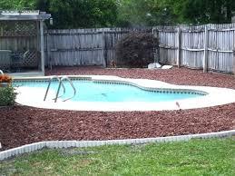 landscaping around above ground pool with rocks rocks aboveground