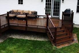 best deck color to hide dirt wood finished deck with wood rails skirt and