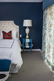 peacock blue walls grey carpet ivory headboard for the home