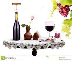 bottle wine glass with flower and food on a table stock images