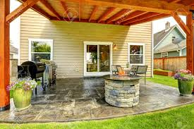 pergola with patio area tile floor decorated with flower pots