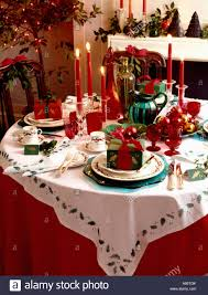 dinner gifts christmas dinner table with ivy stencilled white cloth and red