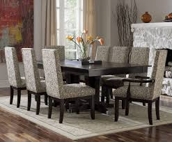 small brown table with black chairs for grey dining room color