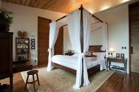 Bed Canopy Curtains Slanted Ceiling Bed Canopy Bedroom Tropical With Wood Flooring