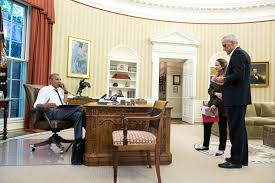 file president obama on the phone in the oval office with