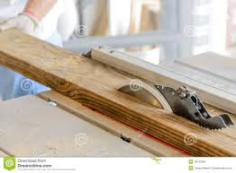 Table Saw Laminate Flooring Man Wood Working Table Saw With Hands And Glove Stock Photo