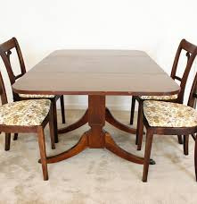 mahogany duncan phyfe style dining table and four chairs ebth