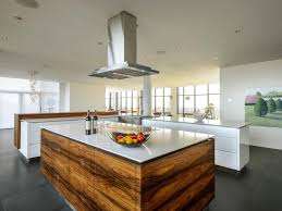 white kitchen cabinets black tile floor modern white kitchen with wood island and black tile