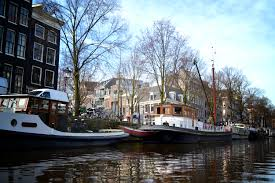 amsterdam apartments experience amsterdam history by having an amsterdam canal cruise