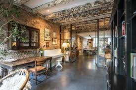 decordemon a stunning industrial garage conversion in amsterdam steel roof lights steel bearings concrete floor in harmony with the materials used in the conversion an oasis of calm in the middle of the city