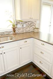 kitchen with painted cream cabinets quartz countertop dark wood