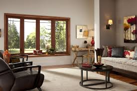 cherry woodgrain bow window simonton windows doors cherry wood grain bow window in spacious living room