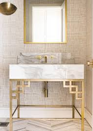 wallpaper designs for bathroom fixed on a wall covered in textured wallpaper a gold sconce