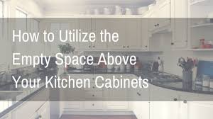how to decorate space above kitchen cabinets how to tuesday utilize the empty space above your kitchen