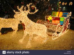 christmas scene in george square illuminated reindeer pulling