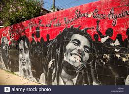 bob marley with benazir bhutto rise all freedom fighters street bob marley with benazir bhutto rise all freedom fighters street mural on a wall in the
