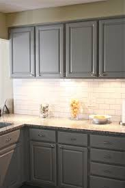 gray cabinets with white subway tile backsplash gray kitchen