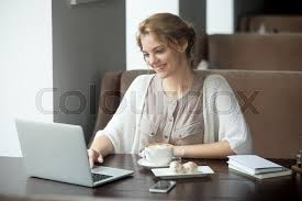 half length portrait of young beautiful female working on laptop