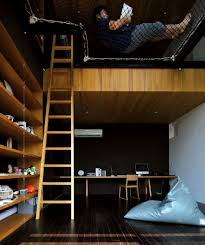 two story room with suspended netting reading nook