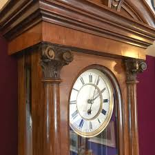 unusual walnut cased single weight vienna wall clock wall clocks