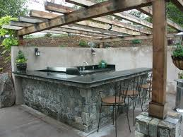 Outdoor Kitchen Creations Orlando by Outdoor Kitchen Cut Into Slope Stone Veneer Finish With Granite
