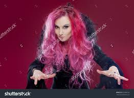 halloween background pink scary witch red hair performs magic stock photo 452496739