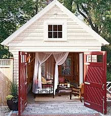 backyard cottage what makes it work large windows and doors invite in lots of light