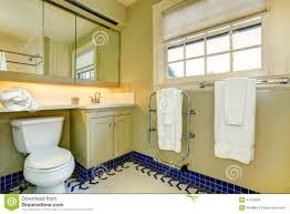 Grey And Yellow Bathroom by Bright Yellow Bathroom With Blue Tile Floor Stock Photos Image
