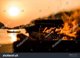 halloween pumpkin head jack lantern with burning candles over black background warm beach camp fire blazin orange stock photo 377669380