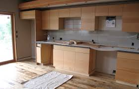 glass countertops reclaimed wood kitchen cabinets lighting