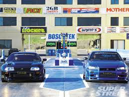 nissan skyline imports australia 1994 toyota supra tt and 2000 nissan skyline gt r black and blue