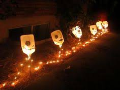 Halloween Decorations Using Milk Jugs - milk jug pumpkins and ghosts with christmas lights halloween