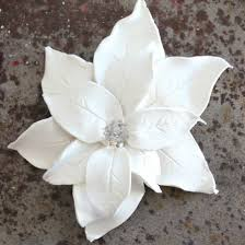 use polymer clay to make ornate life like poinsettias to add to