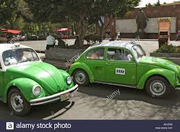 green volkswagen beetle green volkswagen beetle taxis in mexico city city centre stock