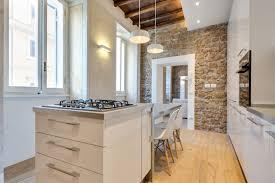 stone wall black microwaves metal countertops brown flooring