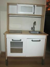 childrens wooden kitchen furniture tikes deluxe wooden kitchen and laundry center wooden